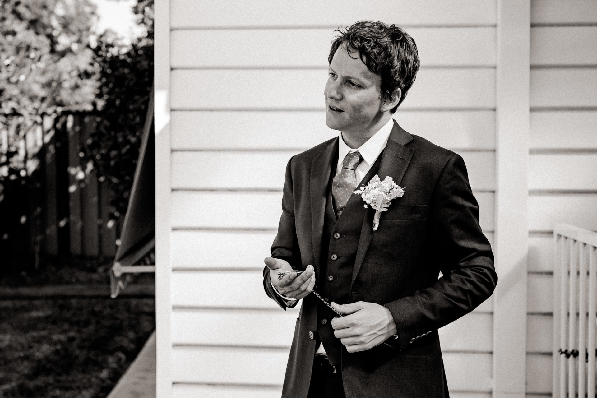 backyard-wedding-australia-melbourne-groom-just-before-first-look-checking-pocket-watch