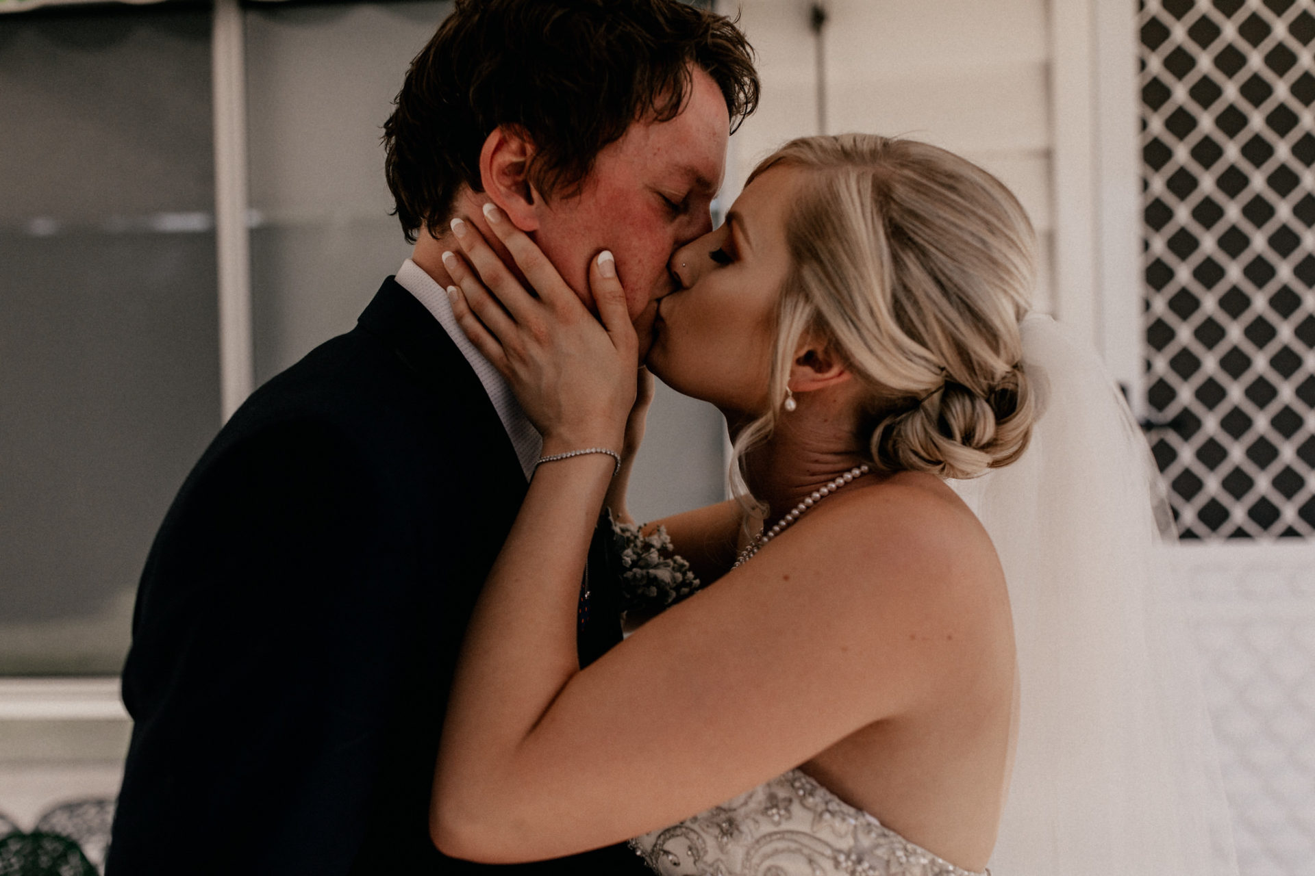 backyard-wedding-australia-melbourne-bride-groom-first-look-dancing-intimate-hug-veil-blue-suit